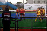 A Hockey Maker watches Spain versus South Africa in torrential rain