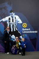 Borussia Dortmund supporting family pose next to picture of Robert Lewandowski