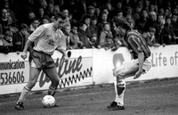 Danny Carter takes on a Bournemouth defender