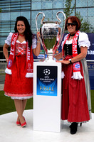 Bayern Munich supporting women in traditional Bavarian dress pose with the European Cup