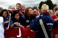 Alex Danson of England signs for young fans
